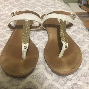 ALDO gold arrow sandals